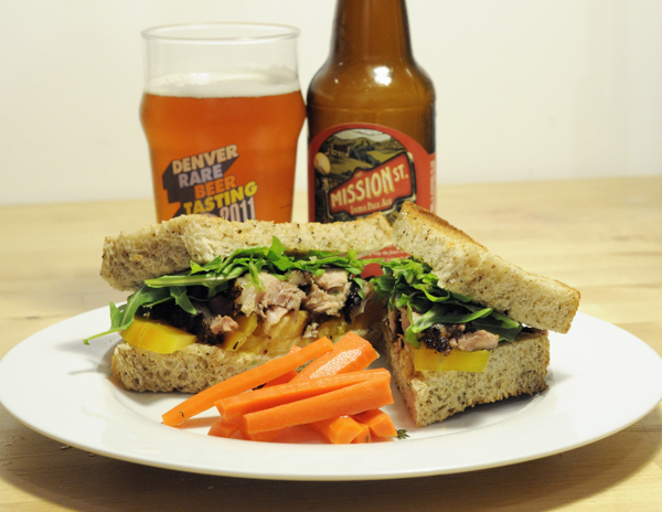Pork belly confit, baby arugula, and heirloom tomato on homemade spent grain sourdough bread. Paired with a side of pickled carrots and Mission Street IPA.