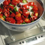 Peppers are roughly chopped and weighed. 2% salt by weight is added to the mix.