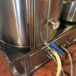 Transferring wort from the mash tun to boil kettle.