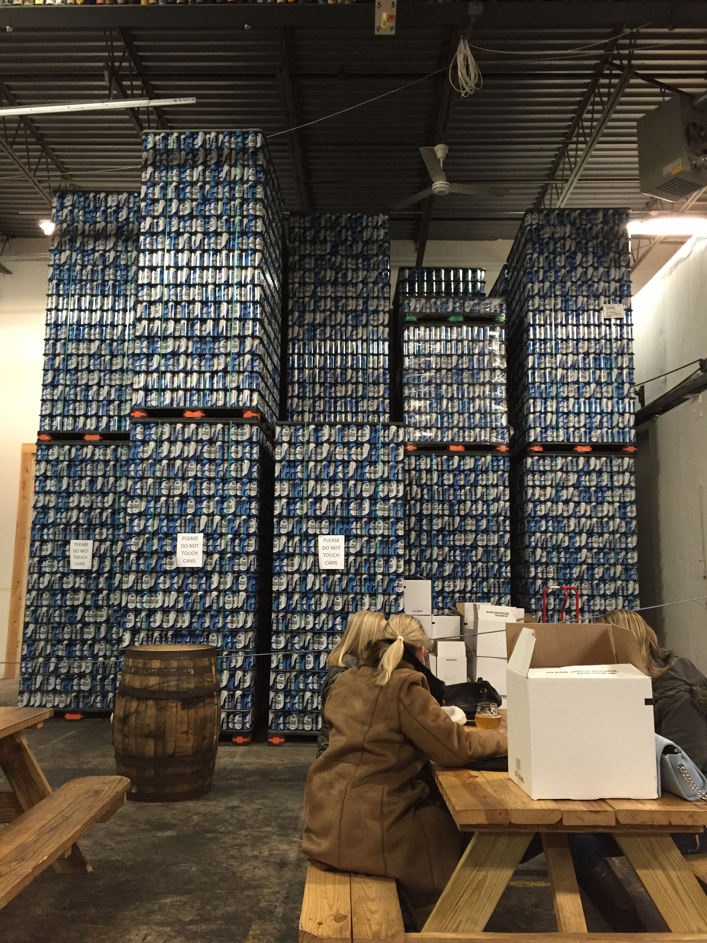 Empty Cans of Head High IPA Stacked High and Ready for Packaging